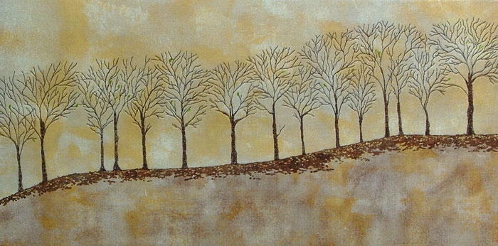 Background is painted in warm yellow tones. Tree silhouettes have been free motion stitched in brown along a ridge. Fallen leaves are painted on the ground at base of trees. The odd green leaf yet to fall.