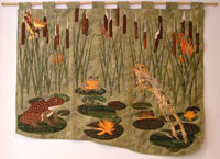 A pond with lily-pads, seven frogs, bullrushes and dragonflies.