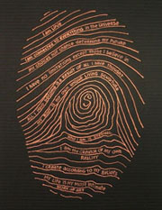 This is the artist's fingerprint in a copper colour on black. Words about identity are written in the fingerprint.